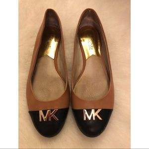 Classic Black and Tan flats from Michael Kors